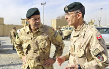 The Chief of the Defence Staff, General Tom Lawson, speaks with Major-General James Ferron during a visit to Kabul to meet with Canadian troops serving in the region as part of Operation Attention.