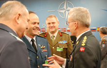 General Tom Lawson speaks with the Chair of NATO's Military Committee (right), and the Bulgarian (foreground) and Estonian (centre background) Chiefs of Defence during a meeting of NATO's Military Committee in Brussels, Belgium.