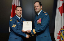 General Tom Lawson (right) presents a Chief of the Defence Staff Commendation to Master-Corporal Jean-François Philipp's during an awards ceremony that was held in Ottawa at National Defence Headquarters in February 2013.