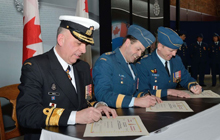 General Tom Lawson (centre) presides over the Chief of Military Personnel Change of Command signing ceremony during a parade that was held in Ottawa on February 20, 2013. Major-General D.B. Millar (right) replaced Rear-Admiral A. Smith (left) as Chief of Military Personnel.