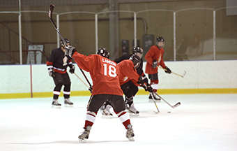 General Tom Lawson prepares to take a one-timer shot during a General Officer / Flag Officer and Foreign Defence Attachés hockey game fundraiser held at the University of Ottawa ice rink on June 26th, 2014. General Lawson wears number 18 on his jersey, as he is the 18th Chief of the Defence Staff.  Photo by: Corporal Pierre Habib
