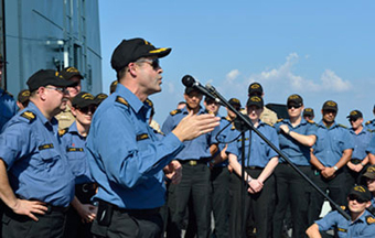 General Tom Lawson, the Chief of the Defence Staff (centre) addresses the crew of HMCS Regina with CPO1 Bob Cleroux (left), the Canadian Forces Chief Warrant Officer, while visiting the ship in the Arabian Sea.