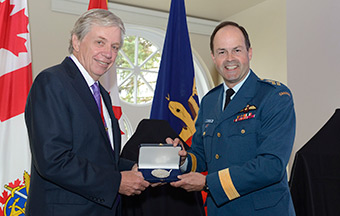 General Tom Lawson, Chief of the Defence Staff, presents the Canadian Forces Medallion for Distinguished Service to Dr. Cecil Rorabeck, President, Royal College of Physicians and Surgeons of Canada in Ottawa, Ontario on May 14, 2014.