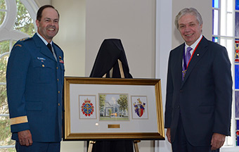 Dr. Cecil Rorabeck, President of the Royal College of Physicians and Surgeons of Canada (RCPSC), presents a gift to General Tom Lawson, Chief of the Defence Staff during a ceremony marking the presentation of the Canadian Forces Medallion for Distinguished Service to the RCPSC in Ottawa on May 14, 2014.