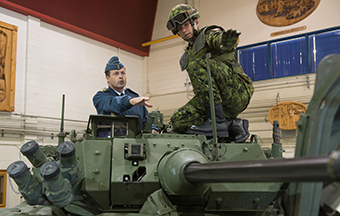 During his first official visit to the 5th Canadian Mechanized Brigade Group on Friday, October 3, 2014 at Courcelette, QC, the Chief of Defence Staff General Tom Lawson receives explanations from Master-Corporal Alexandre Ouellet-Quirion on the 3rd Generation Light Armoured Vehicle weapon system. Photo by: Corporal Nicolas Tremblay, Valcartier Imaging Section, VL2014-0283-009.