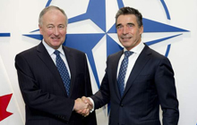 The Honourable Rob Nicholson, Minister of National Defence, with NATO Secretary General, Anders Fogh Rasmussen, at the NATO Defence Ministerial meeting in Brussels, on October 22-23, 2013. Photo credit: NATO