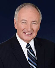 This image is a photograph of the Honourable Robert Nicholson, P.C., Q.C., M.P., Minister of National Defence