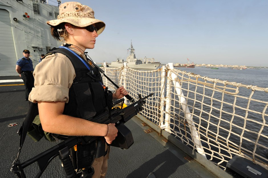 On April 26, 2009 a member of the Naval Boarding Party stands watch as