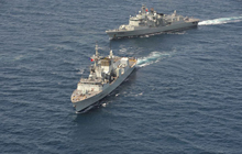 HMCS Winnipeg and the Standing NATO Maritime Group 1 (SNMG1) ships maneuver for a photo opportunity together in the Indian Ocean at the conclusion of a two-day joint naval exercise in April 2009.