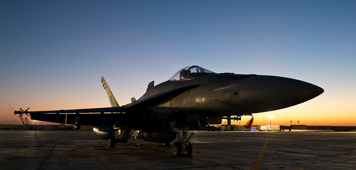 A CF-18 Hornet awaits its next mission in Kuwait during Operation IMPACT on December 2, 2014.
