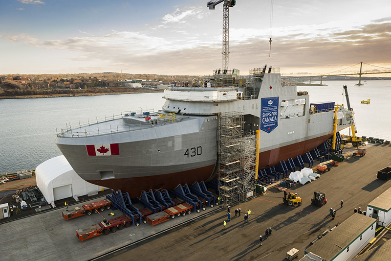 On December 8, 2017, the future HMCS Harry DeWolf's third and final mega-block moved from inside the Halifax Shipyard's Assembly and Ultra Hall facility to the exterior land level construction point, where it joined to the first two mega-blocks to form the complete vessel.