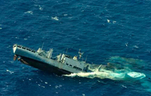 Her Majesty's Canadian Ship (HMCS) Victoria torpedoed and sunk a decommissioned United States Navy ship in the weapons testing range located near the island of Kauai, Hawaii during the Rim of the Pacific (RIMPAC) exercise on July 17, 2012.