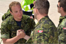 Canadian Forces members helping each other.