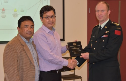On behalf of the DART, LCol Ed Izatt receives a plaque from members of the Nepal Cultural Society of British Columbia.