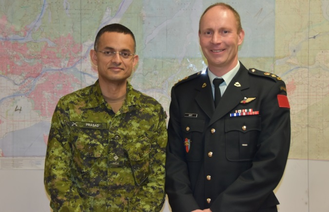 Second Lieutenant Roshan Prasad of Vancouver's 15 Field Regiment, Royal Canadian Artillery, with LCol Ed Izatt.  A Nepalese speaker, Prasad deployed with the DART and proved invaluable helping the team integrate its operations with the Nepalese community. The two were reunited when Izatt briefed members of the Royal United Services Institute (RUSI) at Vancouver's Bessborough Armoury, home to 15 Field. Photo: Capt Jeff Manney
