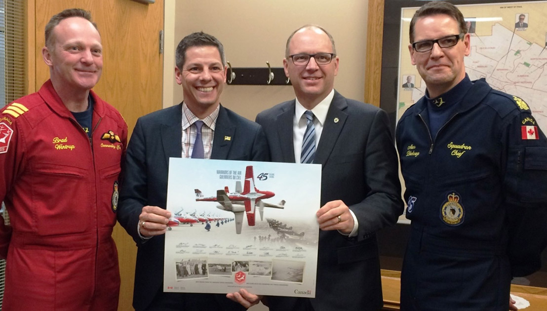 LCol Brad Wintrup and Chief Warrant Officer Alan Blakney present a Snowbirds print to Winnipeg Mayor Brian Bowman (centre left) and Councillor Scott Gillingham, Council Liaison to the Canadian Armed Forces (centre right). The Snowbirds command team visited Winnipeg March 2. Photo: Gloria Kelly