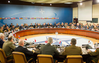 The Chief of the Defence Staff, General Tom Lawson (seated at the table, sixth from the right), joined his North Atlantic Treaty Organization (NATO) counterparts this week for a NATO Military Committee meeting in Brussels, Belgium. This meeting provided the Chiefs of Defence of NATO with an opportunity to discuss and share information on a number of issues relevant to the Alliance. (NATO photo by Sgt. Emily Langer/ Army)