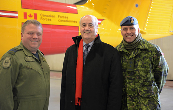 7 April, 2015 - The Honourable Julian Fantino, Associate Minister of National Defence, tours 440 (tpt) Squadron's hanger with Major Steve Thompson and Brigadier-General Greg Loos in Yellowknife, NWT. Based in Yellowknife, 440 Squadron's ski-equipped Twin Otter aircraft are used throughout the north to transport fuel and supplies into geographically challenging locations.