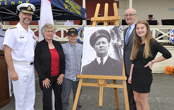 May 25, 2015 – A portrait of Chief Petty Officer (CPO) Max Bernays is unveiled during the naming announcement of the 3rd Arctic/Offshore Patrol Ship held at CFB Esquimalt Naval & Military Museum. From left: Rear Admiral Bill Truelove, Commander Maritime Forces Pacific/Joint Task Force (Pacific); Marilyn Bernays, daughter-in-law of CPO Bernays; Max Thompson, great-grandson of CPO Bernays; the Honourable Julian Fantino, Associate Minister of National Defence; and Carly Bernays, great-granddaughter of CPO Bernays.