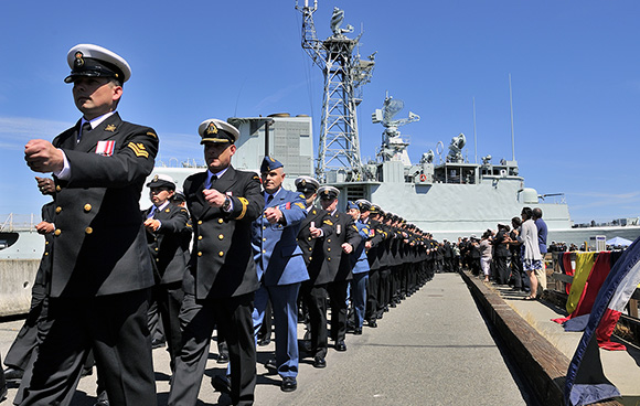 Members of Her Majesty's Canadian Ship (HMCS) ALGONQUIN's crew conduct a march-off during the paying off ceremony held on A Jetty Her Majesty's Canadian (HMC) Dockyard, Canadian Forces Base Esquimalt on June 11, 2015. Photo: LS Zachariah Stopa, MARPAC Imaging Services ET2015-0235-16