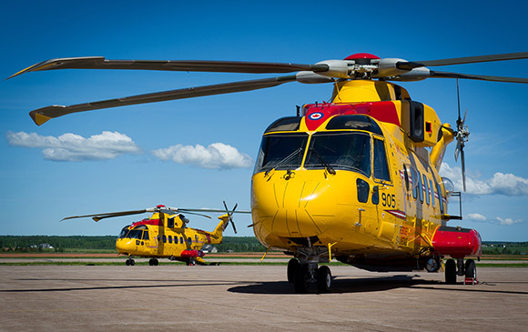 Two CH-149 Cormorant helicopters sit on the tarmac at Summerside Airport, Slemon Park in Prince Edward Island during a boat camp exercise on June 13, 2015. Photo: Master Corporal Johanie Maheu, 14 Wing Imaging – Greenwood, NS GD2015-0334-24