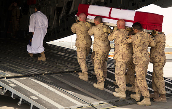 Members of Operation IMPACT carry the casket of Sergeant Andrew Joseph Doiron on to a CC-177 Globemaster for his final journey home, during a ramp ceremony in Kuwait on March 9, 2015. Photo: OP Impact, DND