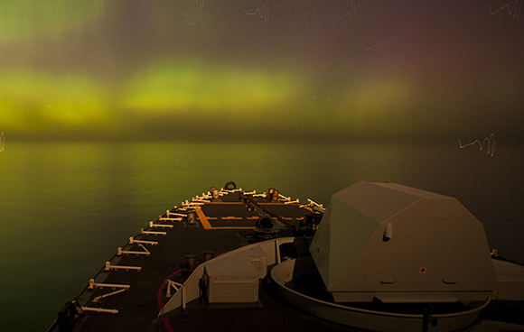 Her Majesty's Canadian Ship FREDERICTON sails under a display of aurora borealis off the coast of Scotland during Exercise JOINT WARRIOR as part of Operation REASSURANCE on April 16, 2015. Maritime Task Force - OP Reassurance, DND HS41-2015-0068-034