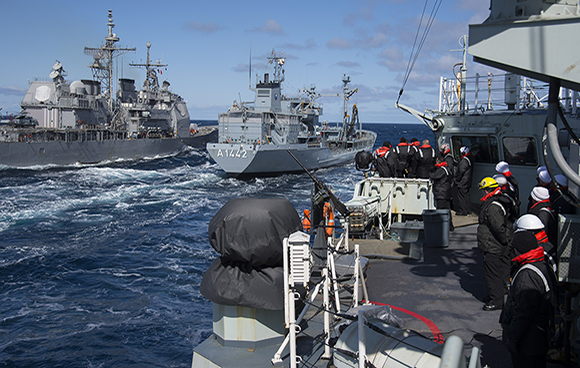 Her Majesty's Canadian Ship FREDERICTON approaches German supply ship FGS SPESSART for a liquid replenishment at sea (RAS) at the same time as United States Ship VICKSBURG (left) conducts a RAS on the port side of FGS SPESSART during Operation REASSURANCE on April 30, 2015. Photo: Maritime Task Force - OP Reassurance, DND HS41-2015-0074-019