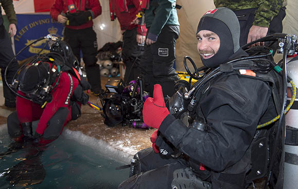 Royal Canadian Navy (RCN) Fleet Diving Unit (Atlantic) Clearance Diver Leading Seaman Caleb Hooper gives a thumbs up before today's dive on the wreck of Her Majesty's Ship (HMS) Erebus from the Sir John Franklin 1845 Arctic expedition during Operation NUNALIVUT on April 14, 2015. Photo: Master Seaman Peter Reed, Formation Imaging Services, Halifax HS42-2015-0273-121