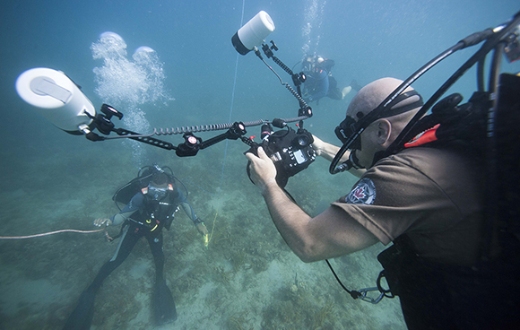 Sergeant Yannick Bedard, Combat Camera Imagery Technician, captures images of students conducting circle searches during Exercise TRADEWINDS 15 in St. Kitts and Nevis on June 3, 2015. Photo: Master Seaman Peter Reed, Formation Imaging Services, Halifax