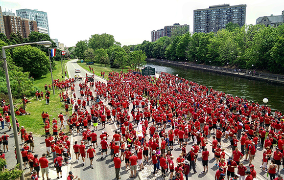 May 29, 2015 - Thousands of supporters walk the 9th annual Walk/Run in Red to show their support for the troops.  The concept of wearing something red is meant to let the soldiers and their spouses and children know they are not alone. Photo by Antonella Ielo