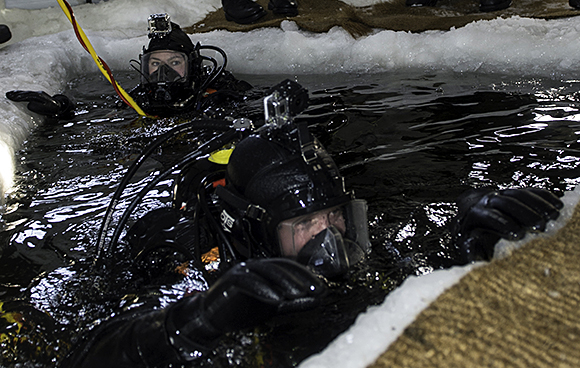 Divers resurface from the St-Laurence River at Quebec City port during an ice dive exercise on February 28, 2015. PHOTO: Cpl Eric Girard