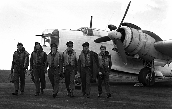 "The first 407 ""Demon"" Squadron crew to take off on D-Day. Left to right: Sergeant C.T. Bryan, Sergeant J. Smith, Flying Officer I. Hoffman, Flying Officer Corrigan, Flying Officer M.N. Gilchrist and Pilot Officer E. Bowler. PHOTO: DND"