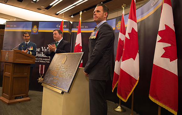 The Honourable Jason Kenney, Minister of National Defence and Warrant Officer (Retired) Patrick Tower unveiled the commemorative plaque at the Valour Building, May 25, 2015, Ottawa, Ontario. The building was renamed during the National Day of Honour commemoration in May 2014, following the end of Canada's mission in Afghanistan. Photo credit: Corporal Carbe Orellana, Canadian Forces Support Unit (Ottawa), Imaging Services ©2015 DND-MDN, Canada SU15-2015-0811-06