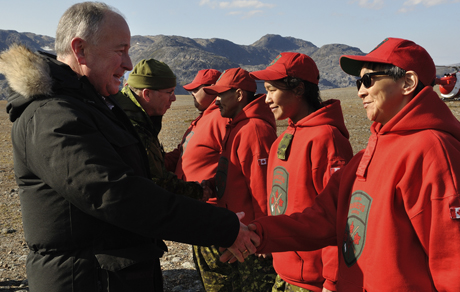Minister of National Defence, the Honourable Rob Nicholson (left), accompanied by Lieutenant-General Stuart Beare (second left) greets members of 1 Canadian Ranger Patrol Group during a visit York Sound, Nunavut, during Operation NANOOK 2014. Minister Nicholson was visiting the camp to witness portions of a whole of a Government consequence management exercise. Photo: Capt Reid