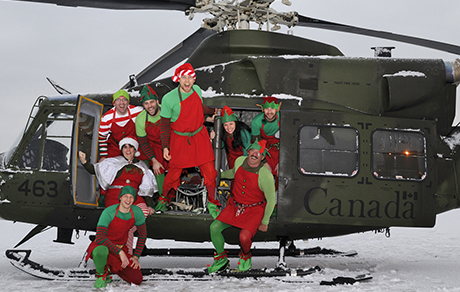 400 Squadron personnel pose in one of the squadron's CH-146 Griffon helicopters before heading to Toronto with gifts to deliver to children at Sick Kids Hospital. PHOTO: Sergeant Kev Parle