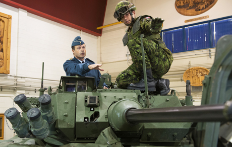 During his first official visit to the 5th Canadian Mechanized Brigade Group on Friday, October 3, 2014 at Courcelette, QC, the Chief of Defence Staff General Tom Lawson receives explanations from Master-Corporal Alexandre Ouellet-Quirion on the 3rd Generation Light Armoured Vehicle weapon system. Photo by: Corporal Nicolas Tremblay, Valcartier Imaging Section.