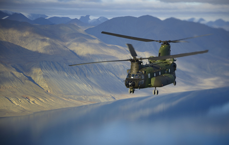 Returning from Canadian Forces Station Alert on August 24, 2014, a CH-147F Chinook helicopter flies over Hazen Lake in Ellesmere Island, Nunavut. PHOTO: Corporal Arthur Ark