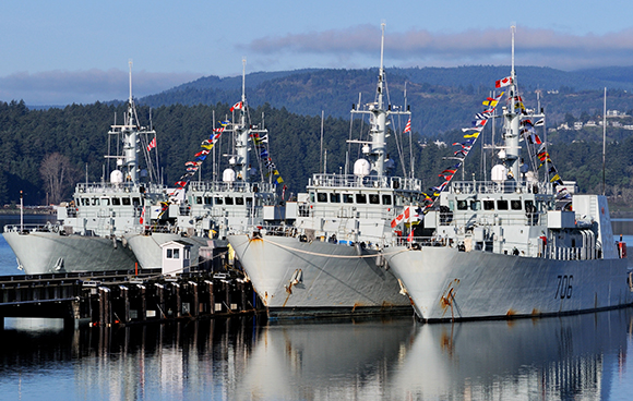 "Her Majesty's Canadian Ships Brandon and Yellowknife from Maritime Forces Pacific in Esquimalt, B.C. were ""dressed overall"" with flags and pennants to celebrate the 50th Anniversary of the National Flag of Canada on February 15, 2015. Photo: Sergeant Angela Abbey, MARPAC Imaging Services"