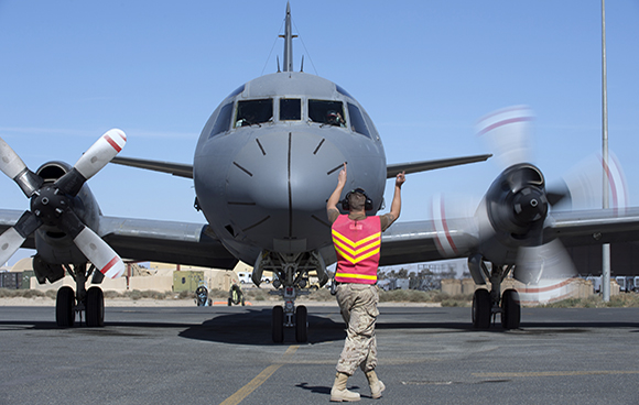 An Aviation Systems Technician from Air Task Force - Iraq prepares a CP-140 Aurora for its next mission during Operation IMPACT on February 1, 2015. Photo: OP Impact, DND