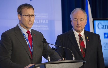 The Honourable Rob Nicholson (right), P.C., Q.C., M.P. for Niagara Falls, Minister of National Defence, with The Honourable Peter MacKay, Minister of Justice and Attorney General, speak with the media during the opening of the Halifax International Security Forum in Halifax, Nova Scotia, on November 21, 2014. Photo: Leading Seaman Peter Frew, Formation Imaging Services © 2014 DND-MND Canada