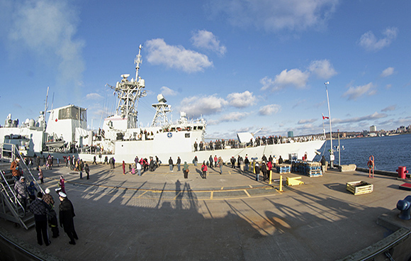 Family and friends of ship's crew say goodbye to HMCS Fredericton as she departs on December 30, 2014 for Operation REASSURANCE in the Mediterranean Sea. Photo: John Clevett, Formation Imaging Services, Halifax, NS