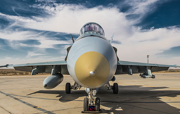 A CF-18 Hornet aircraft sits on the tarmac waiting for its next mission during Operation IMPACT in Kuwait on February 1, 2015. Photo: Canadian Forces Combat Camera, DND