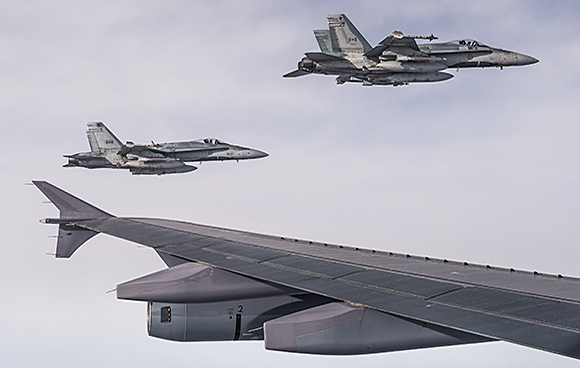Two CF-18 Hornets escort a CC-150 Polaris after being refueled during Operation IMPACT on February 4, 2015.Photo: Canadian Forces Combat Camera, DND