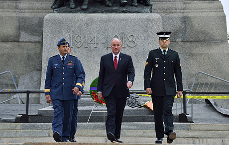 General Tom Lawson (left), Chief of Defence the Staff and The Honourable Rob Nicholson (centre), Minister of National Defence return after laying a wreath in front of the National War Memorial during a Commemoration event in Ottawa, Ontario on October 23, 2014.