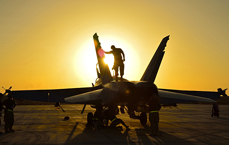 Royal Canadian Air Force ground crew perform post flight checks on a CF-18 fighter jet in Kuwait after a sortie over Iraq during Operation IMPACT on November 3, 2014. Photo: Canadian Forces Combat Camera, DND IS2014-5026-03
