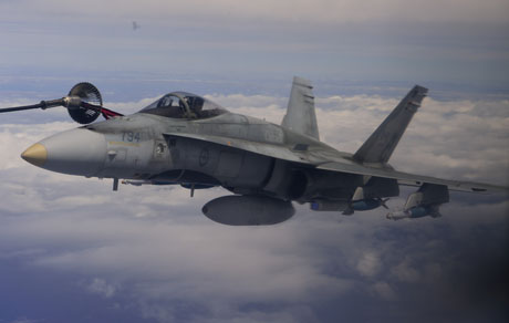 A Royal Canadian Air Force (RCAF) CF-18 Hornet connects to the basket of a RCAF CC-130T Hercules to refuel just off the coast of Hawaii during the Exercise Rim of the Pacific (RIMPAC) on July 14, 2014.Photo: Sgt Matthew McGregor, Canadian Forces Combat Camera