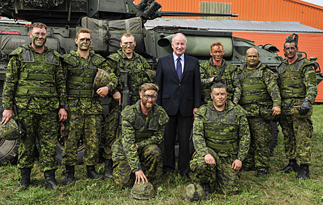 The Honourable Robert Nicholson, Minister of National Defence, poses with a Royal Canadian Dragoons LAV III crew participating in Exercise STALWART GUARDIAN held in the Niagara Region, Ontario on August 20, 2014.  Photo: MCpl Dan Pop, 4 Cdn Div Public Affairs