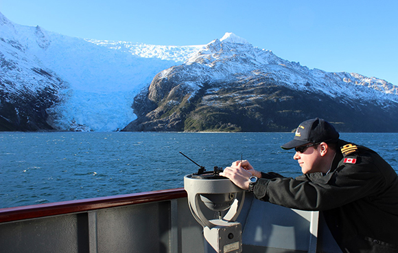 Sub-Lieutenant Chris Sulyma takes a bearing while on board the Chilean Navy auxiliary patrol ship PSG-78 Piloto Sibbald in Beagle Channel, off Chile's southern coast, during his exchange with the Chilean Navy through the RCN's REGULUS program. Photo courtesy of Chris Sulyma.