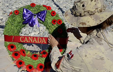 Canadian Armed Forces members hold a Remembrance Day ceremony at the Joint Task Force Headquarters in Kuwait during Operation IMPACT on November 11, 2014. Photo: Canadian Forces Combat Camera